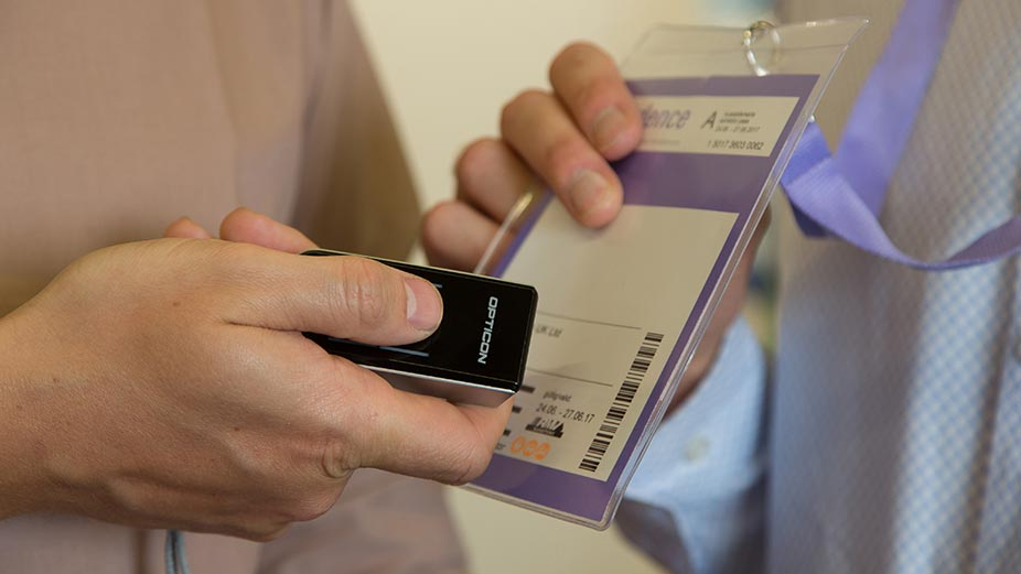 Person scans the ticket of a trade visitor at Messe Frankfurt