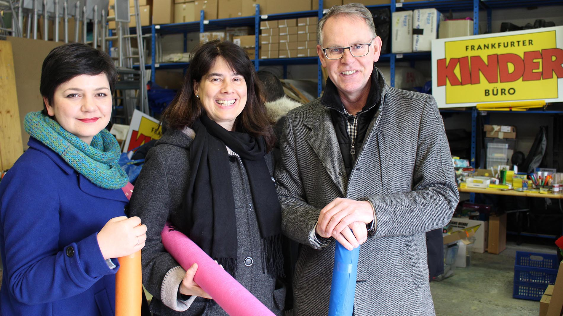 Margit Herberth, Director of Consumer Marketing and Communication, Messe Frankfurt, Madeleine Michaelis, Project Leader, Frankfurter Kinderbüro, and Michael Reichhold, Creativeworld Director, Messe Frankfurt, at the distribution of donations in the Frankfurter Kinderbüro storeroom.