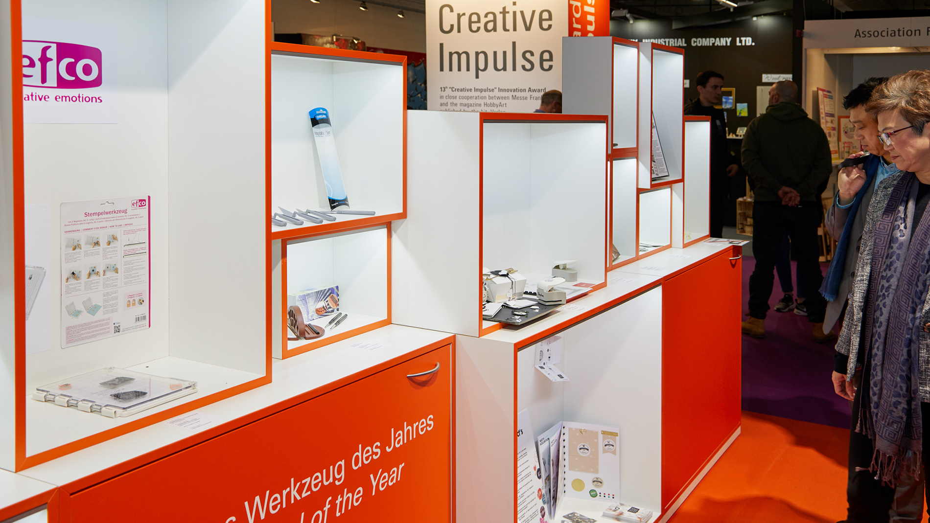 Visitors look at the innovations of the creative industry in the Creative Impulse special show