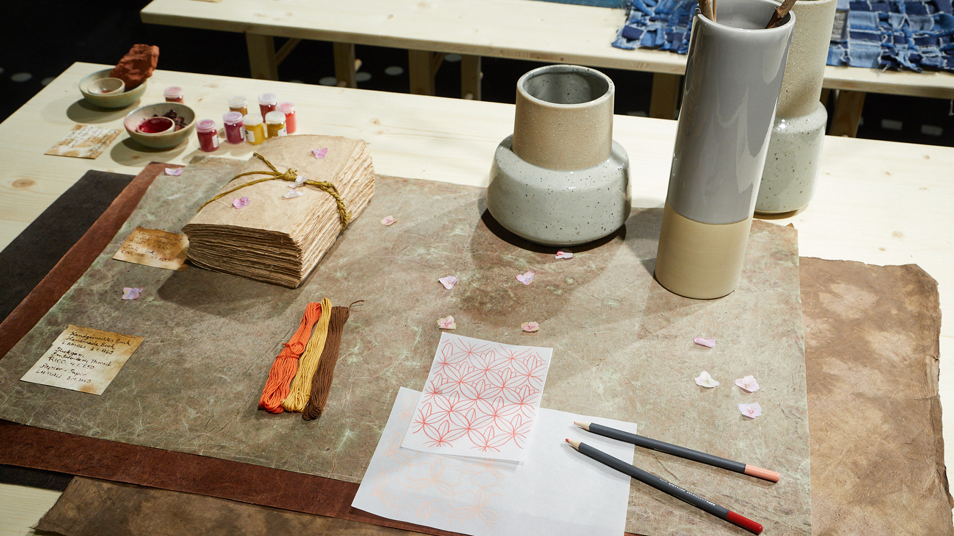 Vases and notebook in natural tones on the Creativeworld