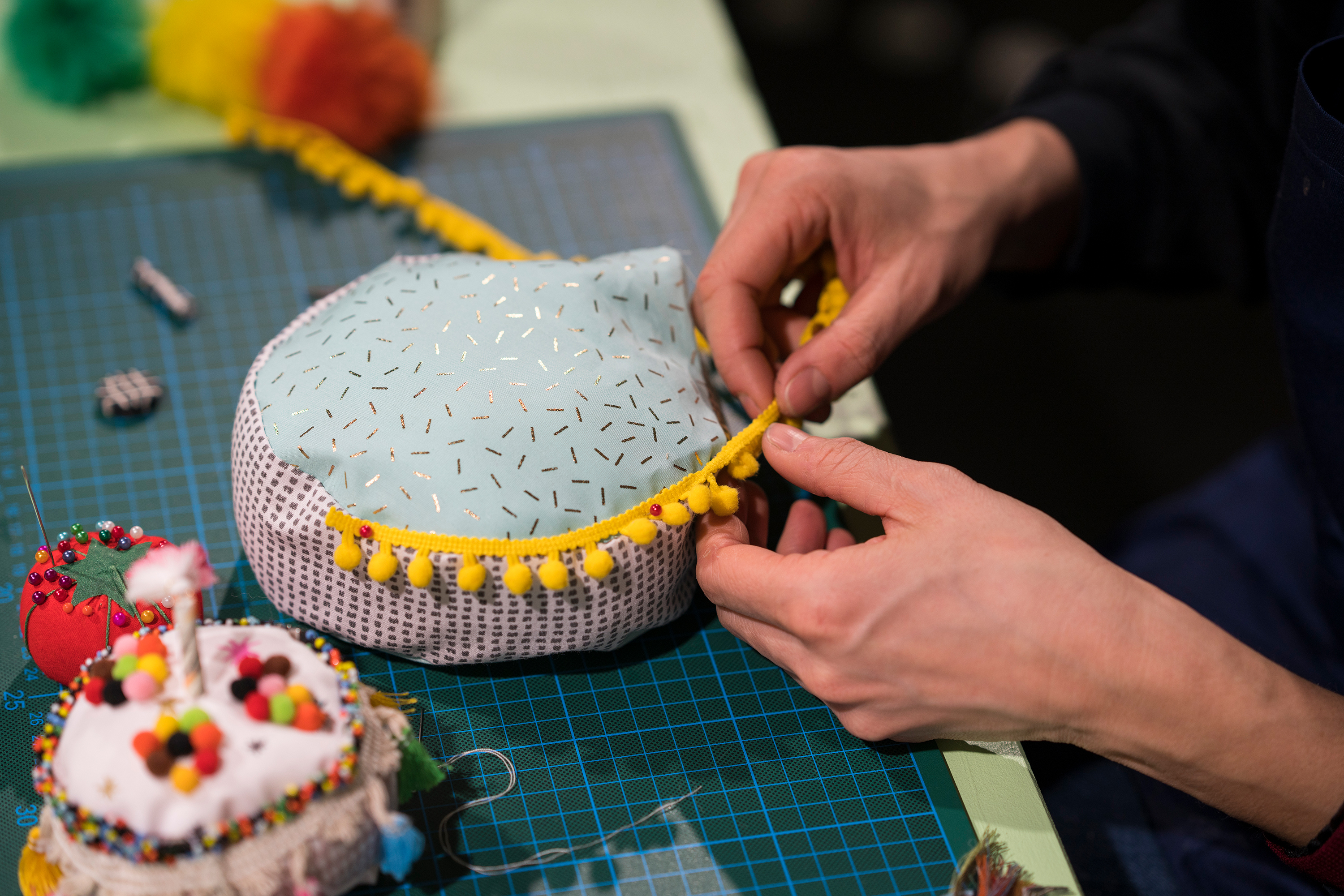 Woman is making a cake out of fabric
