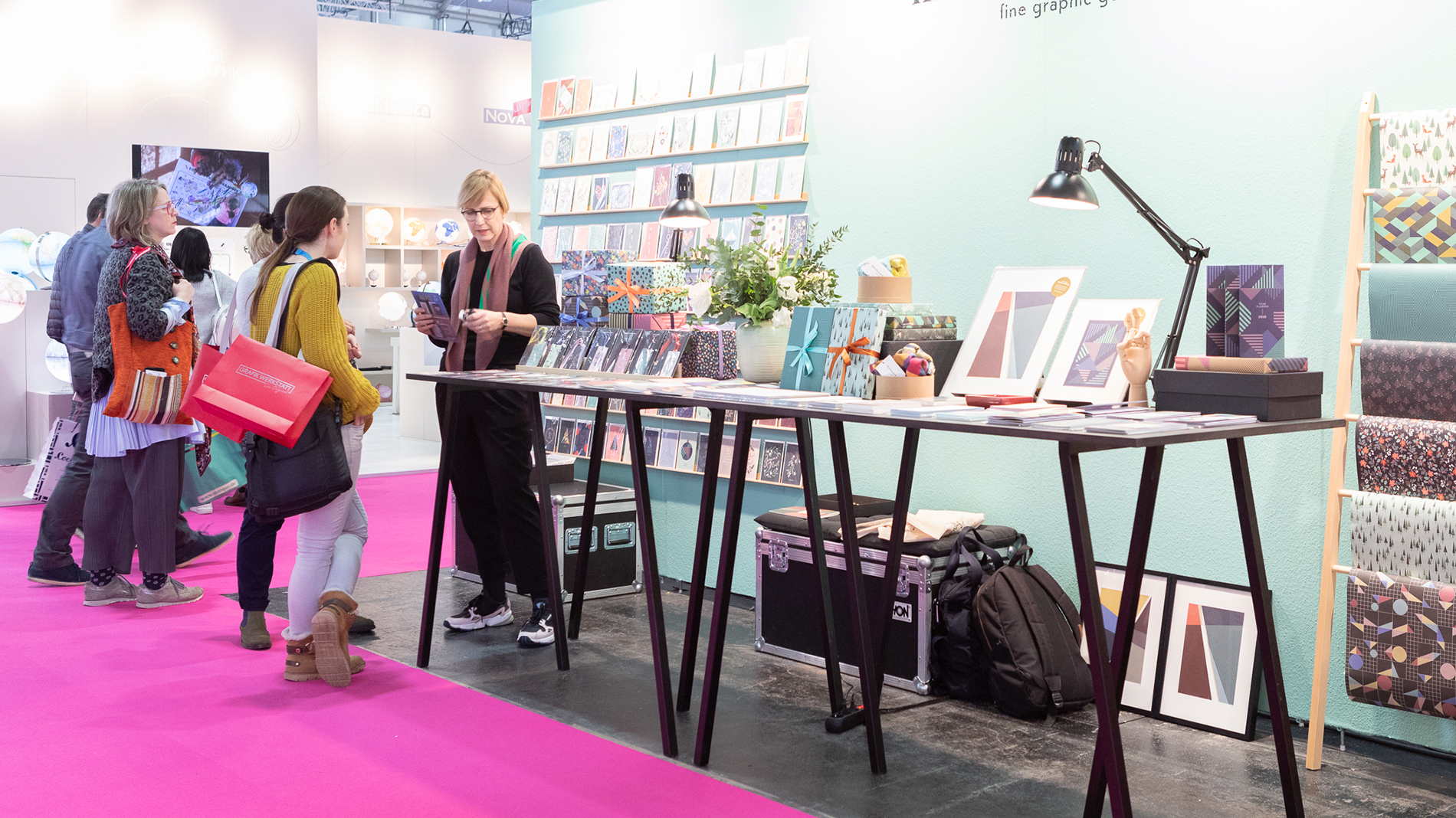 Visitors at a booth at Paperworld